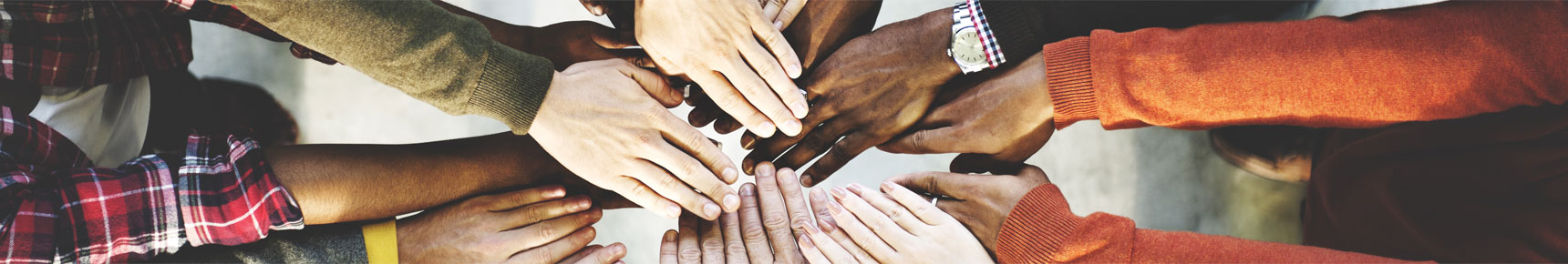 Hands of different colours symbolizing working together