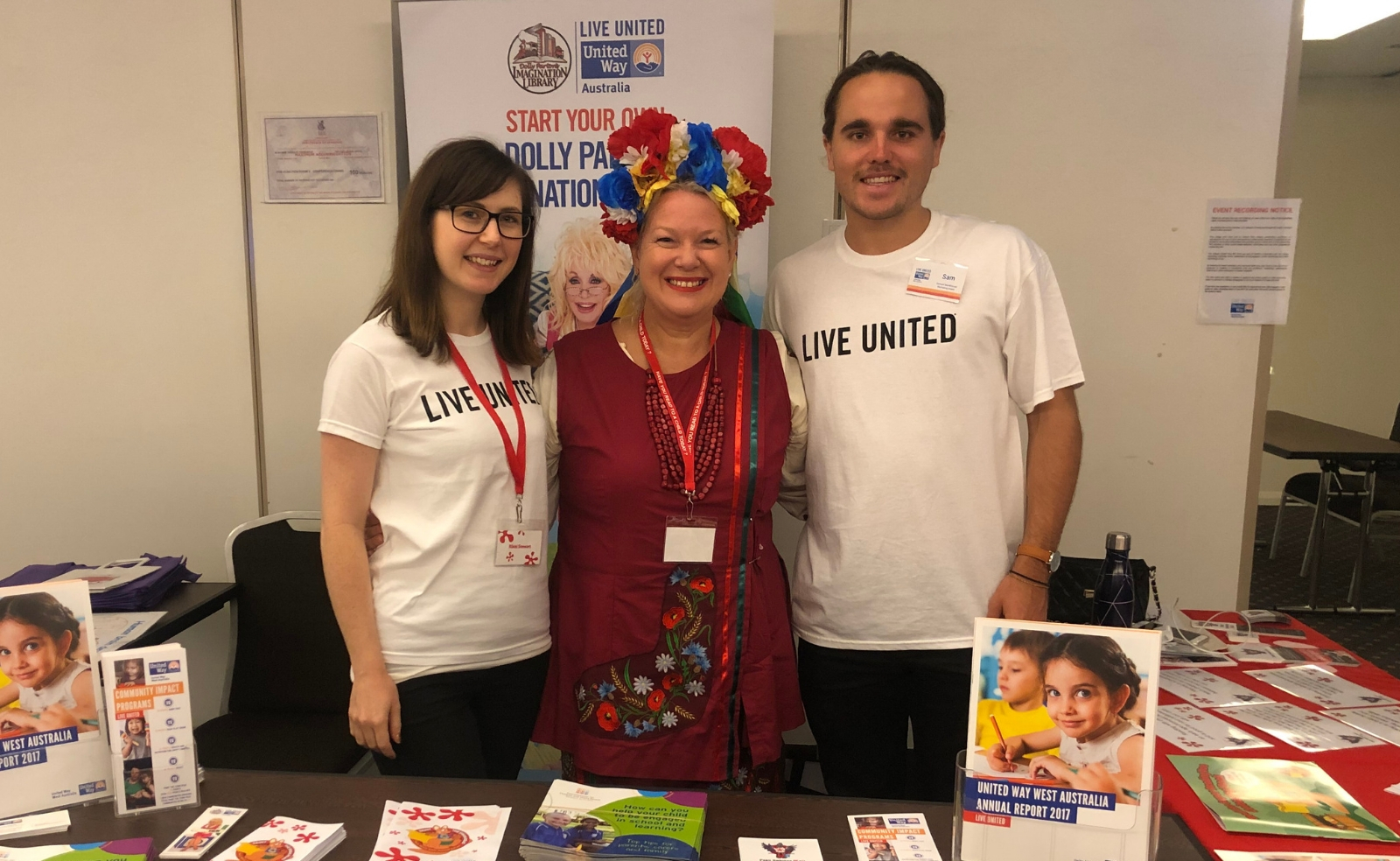 People with 'Live United' printed on their Tshirts